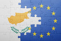 Puzzle with the national flag of cyprus and european union
