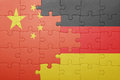 Puzzle with the national flag of germany and china
