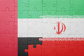 Puzzle with the national flag of iran and united arab emirates
