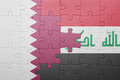 Puzzle with the national flag of iraq and qatar