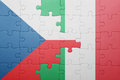 Puzzle with the national flag of italy and czech republic