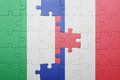 Puzzle with the national flag of italy and france