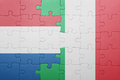Puzzle with the national flag of italy and netherlands