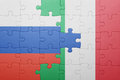 Puzzle with the national flag of italy and russia Royalty Free Stock Photo