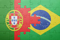 Puzzle with the national flag of portugal and brazil Royalty Free Stock Photo