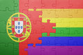 Puzzle with the national flag of portugal and gay flag