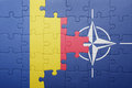 Puzzle with the national flag of romania and nato