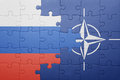 Puzzle with the national flag of russia and nato