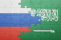 Puzzle with the national flag of saudi arabia and russia