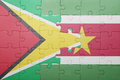 Puzzle with the national flag of suriname and guyana