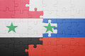Puzzle with the national flag of syria and russia