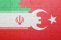 Puzzle with the national flag of turkey and iran