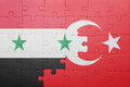 Puzzle with the national flag of turkey and syria
