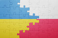 Puzzle with the national flag of ukraine and poland