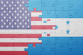 Puzzle with the national flag of united states of america and honduras Royalty Free Stock Photo