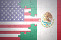 Puzzle with the national flags of united states of america and mexico