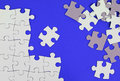 Puzzle pieces on blue background Royalty Free Stock Photo
