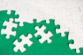 Puzzle pieces on green background close up Royalty Free Stock Image