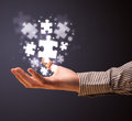 Puzzle pieces in the hand of a businessman Royalty Free Stock Photo