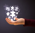 Puzzle pieces in the hand of a woman Royalty Free Stock Photo