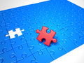 Puzzle pieces, the red solution piece is missing Royalty Free Stock Photo