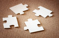 Puzzle pieces on wooden background. business or team concept. selective focus . Royalty Free Stock Photo
