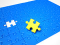 Puzzle pieces, the yellow  piece is missing Stock Image