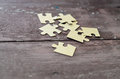 Puzzle on wooden background Royalty Free Stock Photo