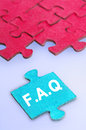 Puzzle word faq on blue background Stock Images