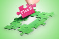 Puzzle word plan b on green background Royalty Free Stock Image