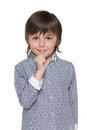 Puzzled little boy a is standing against the white background Royalty Free Stock Photography