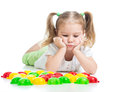 Puzzled little girl playing with mosaic toy Royalty Free Stock Photo