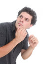Puzzled man on a white background Royalty Free Stock Images