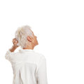 Puzzled older woman scratching her head Royalty Free Stock Photo