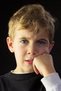 A puzzled young boy shows disagreement and disgust Stock Photo