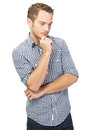 Puzzled young man isolated over white in checkered shirt Royalty Free Stock Image