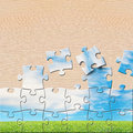 Puzzles with beautiful landscape on wooden table it Royalty Free Stock Photo