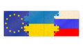 Puzzles of stacked flags european union russia and ukraine Stock Photo
