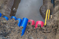 Pvc pipes in a ditch with colorful on construction site Royalty Free Stock Image