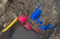 Pvc pipes in a ditch with colorful on construction site Royalty Free Stock Photos