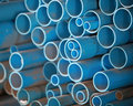 Pvc pipes in store color blue Royalty Free Stock Photos