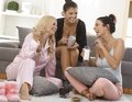 Pyjama party roommates spending an evening together in pyjamas chatting having fun Royalty Free Stock Photos