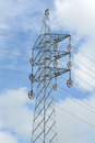 Pylon electric tower against a bright blue sky Royalty Free Stock Images