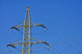 Pylon image of an electricity shot against a blue sky Stock Photo