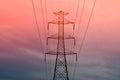 Pylon with power lines against orange sky - twilight Royalty Free Stock Photo