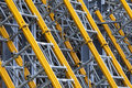 Pylons steel support support poles for walls and buildings some are yellow Stock Image