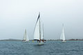 PYLOS, GREECE - Sailboats participate in sailing regatta among Greek island group Royalty Free Stock Photo