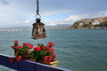Pylos the town of under rain street torch and flowers on balcony messenia navarino bay greece Royalty Free Stock Images