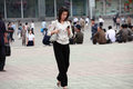 Pyongyang female with mobile phone holding a on the street in in recent years penetration is growing rapidly Royalty Free Stock Photos