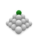 Pyramid of balls with a green top Stock Images